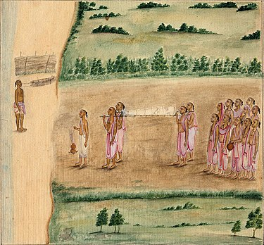 An 1820 painting showing a Hindu funeral procession in South India. The pyre is to the left, near a river, the lead mourner is walking in front, the dead body is wrapped in white and is being carried to the cremation pyre, relatives and friends follow. Hindu funeral.jpg