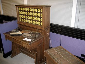 Batch processing - Replica of Hollerith machine (circa 1890), with decks of cards in a box.
