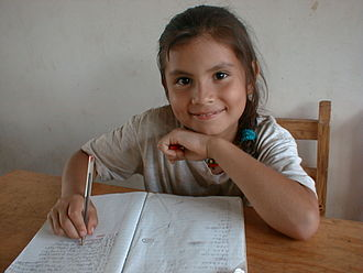 Choluteca, Choluteca - A girl with notebook, in new school's classroom, provided by the charity Solar net Village as a project in a San Ramón school, Choluteca in 1999.