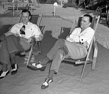 Hoover and his assistant Clyde Tolson sitting in beach lounge chairs, c. 1939