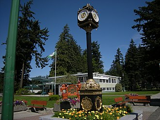 Hope, British Columbia - Municipal building and street clock with Memorial Park in background