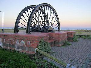 Horden - Horden Colliery memorial pit wheel.