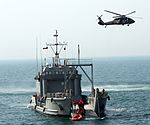 Hovering above the USAV Fort Donelson 150824-A-PD204-820.jpg