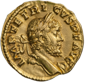 The obverse of a golden coin showing the face of Tetricus.