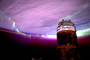 Kounotori 5 - View of the docked Kounotori 5 spacecraft from the Cupola, with Aurora Australis in the background.