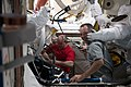 ISS-55 Scott Tingle and Ricky Arnold wrap up spacesuit work in the Quest airlock.jpg