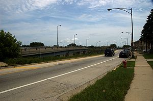 Illinois Route 72 - Looking east at Illinois Route 72 just west of Illinois Route 43 (Harlem Avenue). Due to a lack of right-of-way, the western lanes are routed onto a two-lane bridge over the eastbound exit ramp from Interstate 90 (Kennedy Expressway) to Harlem Avenue.