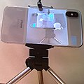 Iphone on tripod in front of a mirror triped by delayed-action shutter release.jpg