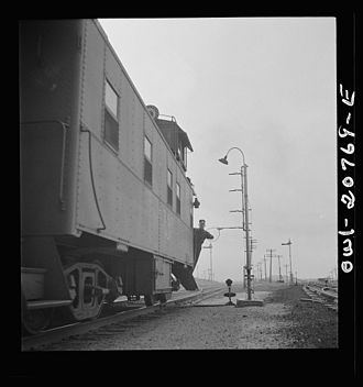 Train order operation - Picking up train orders on the ATSF in Isleta, New Mexico in 1943