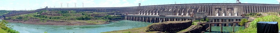Panoramic view of the Itaipu Dam, with the spillways (closed at the time of the photo) on the left. In 1994, the American Society of Civil Engineers elected the Itaipu Dam as one of the seven modern Wonders of the World.