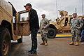 "J.R. Martinez, left, the winner of the 13th season of ABC's ""Dancing with the Stars"" and a former U.S. Soldier with the 101st Airborne Division, looks inside a Humvee outside the headquarters of his old unit 111204-A-PY395-005.jpg"