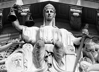 Ouster clause - A sculpture of Lady Justice in the tympanum of the Old Supreme Court Building in Singapore. Ouster clauses seek to exclude courts from reviewing actions and decisions of the executive branch of government.