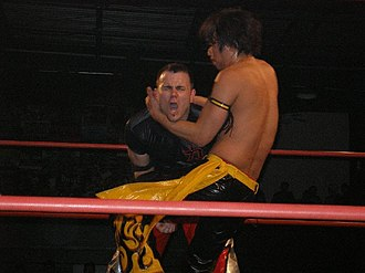 Kudo (wrestler) - Kudo performing a knee strike on Mike Quackenbush