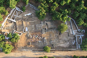 Tel Kabri - Aerial photo of palace at Tel Kabri. 2013 excavation team is lying on  painted plaster floor, spelling out Kabri.