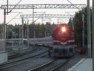 Turkish State Railways - A DE22000 series locomotive pulls the Karesi Express into Menemen