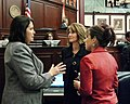 Kelli Stargel, Marti Coley, and Rachel Burgin confer during the consideration of the budget on the House floor.jpg