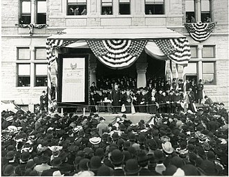 Catholic University of America - The Knights of Columbus presented a check to the Catholic University of America on the steps of the university's McMahon Hall in 1904 to establish a Chair of American History.
