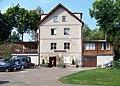 Kožlany, rekreační středisko Ve mlejně, hlavní budova (01).jpg