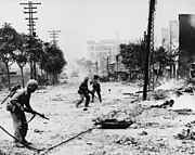 Urban combat in Seoul, 1950, as U.S. Marines fight North Koreans holding the city.