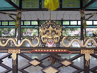 Ornate railing with a mask