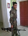 Kurdish YPG Fighter (11496995526).jpg