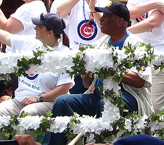 Ernie Banks - Banks and Cubs co-owner Laura Ricketts on the float representing the Cubs organization at the 2010 Chicago Pride Parade