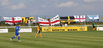 Leamington F.C. - Leamington FC fans display their flags at the New Windmill Ground