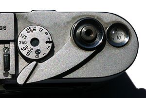 Leica M3 - Speed shutter dial, advance lever with shutter button, and frame counter.