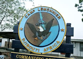 Camp Lemonnier - A sign bearing the Camp Lemonnier patch.