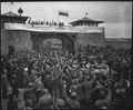 Liberated prisoners in the Mauthausen concentration camp near Linz, Austria, give rousing welcome to Cavalrymen of... - NARA - 531293.tif