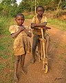 Life style in my village, children with a local wooden bicycle.jpg