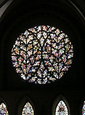 A very elaborate rose window with tracery forming a pattern like two ears of wheat.