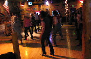 Line dance - American line dancing at a Country Western Dance Hall.