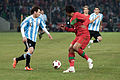 Lionel Messi (L), Bruno Alves (R) – Portugal vs. Argentina, 9th February 2011.jpg