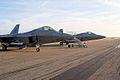 Lockheed-Martin F-22A-30-LM Raptors 05-099 and 05 107 RFronts Dawn SNF 04April2014 (14399713990).jpg