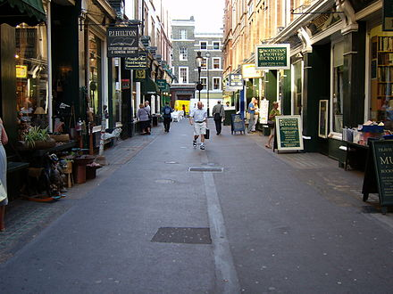 Cecil Court, the street in which the Mozart family found lodgings on arriving in London, April 1764 (2005 photograph) London Cecil Court.jpg