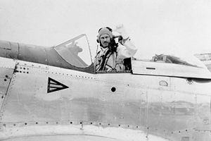 Man in flying suit in the cockpit of a single-seat fighter