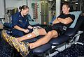 Lt. Rachel Dombart, right, conducts a physical therapy session with Aviation Ordnanceman 2nd Class Mark Gill aboard the aircraft carrier USS George H.W. Bush (CVN 77) in the Atlantic Ocean Aug. 14, 2013 130814-N-MU440-016.jpg