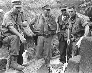 Lewis J. Fields - MG Lewis J. Fields, CG, 1st Marine Division, COL Haffey, CO, 7th Marines, and LTC Utter, CO, 2/7, discusses the results of the operation in Chau Thuan Village, April 1966.