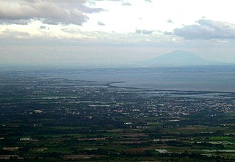 Geography of the Philippines - The plains of Central Luzon, showing the Manila Bay with Mount Arayat in the background