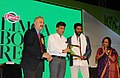 Manish Tewari presenting the Limca Book of Record 'People of the Year'2013 to Film Actor, Shri Prabhu Deva, at a function, in New Delhi on April 10, 2013.jpg
