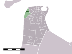 The village centre (darkgreen) and the statistical district (lightgreen) of Huisduinen in the municipality of Den Helder.