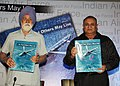 "Marshal of the Indian Air Force Arjan Singh and the Chief of the Air Staff; Air Chief Marshal P.V. Naik releasing the IAF Coffee Table Book ""So that other may live"", in New Delhi on June 23, 2011.jpg"
