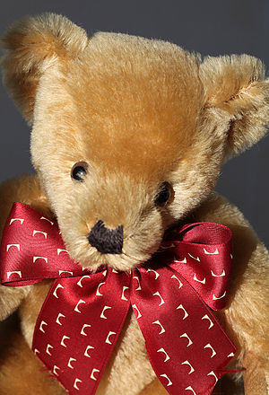 Merrythought - A Merrythought teddy bear from the 2000s, made with mohair and with a bow decorated with Iron Bridges.