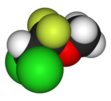 A apace-filling model, or three-dimensional structure of the methoxyflurane molecule, in red, yellow, green, black and white.