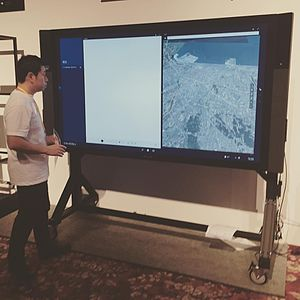 "Surface Hub - 55"" Surface Hub in use with Skype for Business, Microsoft Whiteboard and Maps."