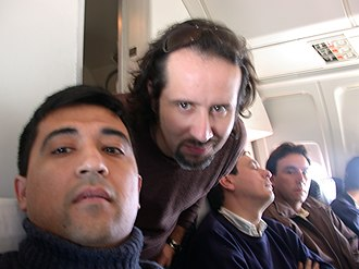 Los Prisioneros - Miguel Tapia (middle) on a plane bound for a fan Iquique in 2004.
