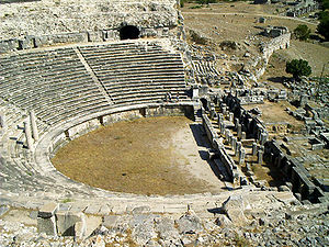 The lower half of the benches and the remnants of the scene building of the theater of Miletus (August 2005)