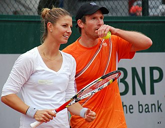 Minella and Alexander Peya in the mixed doubles event at the 2013 French Open Minella and Peya (8954504186).jpg