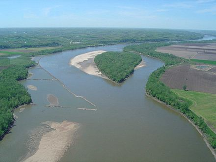 The Missouri River near New Haven, Missouri, looking upstream - note the riprap wing dam protruding into the river from the left to direct its flow into a narrower channel Missouririver1.jpg